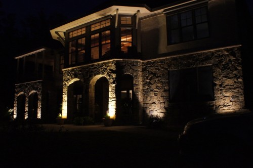 The stonework of this beautiful Dalton home can now be appreciated day and night.